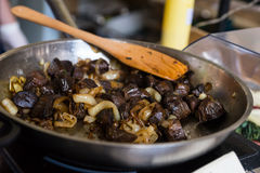 Mushrooms and Onions Cooking in Metal Frying Pan Stock Image