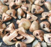Mushrooms and onions in a pan Royalty Free Stock Photo