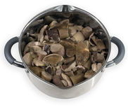 The mushrooms in the pan. Cooked mushrooms in the pan Royalty Free Stock Photos