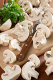 Mushrooms and parsley. On the board Royalty Free Stock Image
