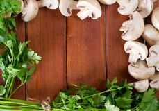 Mushrooms and parsley. On the board Royalty Free Stock Images