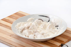 Mushrooms poached in flour prepared for frying Royalty Free Stock Photography