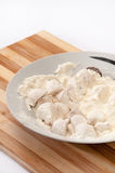 Mushrooms poached in flour prepared for frying Stock Photos