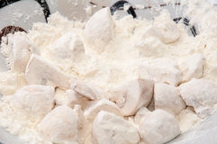 Mushrooms poached in flour prepared for frying Stock Photo