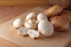 Mushrooms and potatoes Stock Photography
