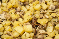 Mushrooms and potatoes frying in a pan Stock Photography