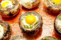 Mushrooms with quail`s eggs Stock Photos