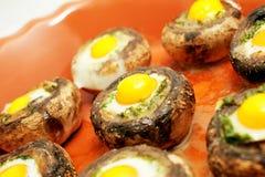 Mushrooms with quail`s eggs Royalty Free Stock Photos