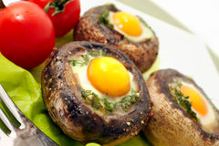 Mushrooms with quail`s eggs Royalty Free Stock Photography