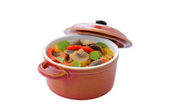 Mushrooms ragout with sweet peppers in casserole, isolated Stock Photos