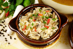 Mushrooms And Rice. Delicious mushrooms, peppers and rice dish ready to serve stock images