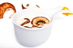 Mushrooms sauce in a white gravy boat Royalty Free Stock Photography