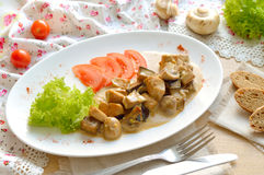 Mushrooms with sauce  on the white plate Stock Image