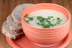 Mushrooms soup. On bowl with cereal bread Stock Images
