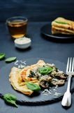 Mushrooms spinach cheese Crepes Stock Photo