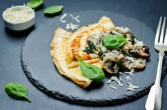Mushrooms spinach cheese Crepes Royalty Free Stock Image