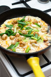 Mushrooms and spring onion omelet Stock Photography