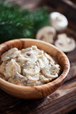 Mushrooms stewed in sour cream Royalty Free Stock Photos