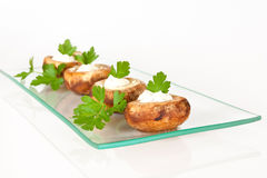 Mushrooms stuffed with cream. And decorated con parsley Royalty Free Stock Images