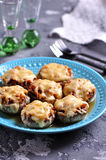 Mushrooms stuffed with fried chicken, onion and hard cheese baked in the oven. Food Royalty Free Stock Photography