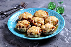 Mushrooms stuffed with fried chicken, onion and hard cheese baked in the oven. Food Royalty Free Stock Photos