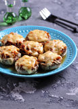 Mushrooms stuffed with fried chicken, onion and hard cheese baked in the oven. Food Royalty Free Stock Images