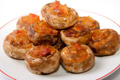 Mushrooms stuffed with fried vegetables Royalty Free Stock Images