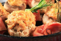 Mushrooms stuffed with ground meat. And slices of Parma ham Royalty Free Stock Images