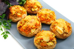 Mushrooms stuffed with vegetables and chicken. Stock Photo