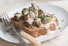 Mushrooms on toast. Chestnut mushrooms with garlic and creme fraiche on toast stock photography