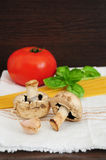 Mushrooms, tomato, garlic and spaghetti Stock Photography