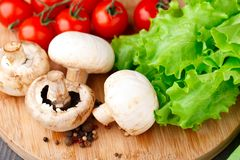 Mushrooms, tomato, lattuce and pepper Royalty Free Stock Photos