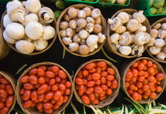 Mushrooms and Tomatoes. Small baskets of organically grown mushrooms and cherry tomatoes Stock Photo