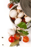 Mushrooms, tomatoes and herbs Royalty Free Stock Photos