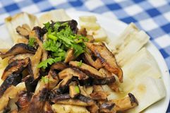 Mushrooms topping on brinjal cuisine Stock Photography
