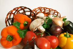 Mushrooms and a variety of fresh vegetables in a wicker basket.i. Solated on a white background.photo with copy space Royalty Free Stock Image