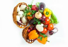 Mushrooms and a variety of fresh vegetables in a wicker basket.i. Solated on a white background.photo with copy space Stock Photo