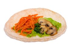 Mushrooms with vegetables on the bread tortilla stock photo