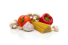 Mushrooms, vegetables and pasta on a white background Stock Images