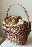 Mushrooms in wicker basket. Wicker basket with mushrooms on the table Royalty Free Stock Photo