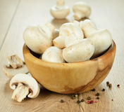 Mushrooms in a wooden bowl Stock Photos