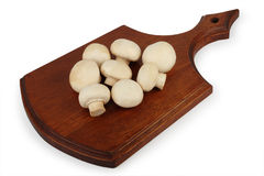 Mushrooms on a wooden chopping board Royalty Free Stock Photography