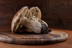 Mushrooms on a wooden cutting board Royalty Free Stock Photo
