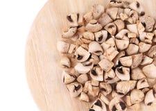 Mushrooms on wooden platter. Royalty Free Stock Photo