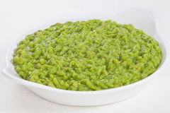 Mushy Peas. A bowl of mushy peas, Britain's favourite food for eating with fish and chips, and pies Stock Photography