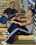 Music. Young men playing guitar on stairs Royalty Free Stock Images