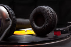 Music. Earphones and phonograph playing music Royalty Free Stock Images