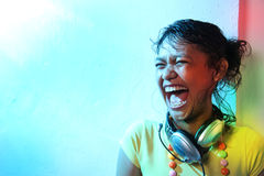 Music. Woman exciting on colorful music Royalty Free Stock Image