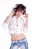 Music. Young model with head phones listening loud music Stock Photos