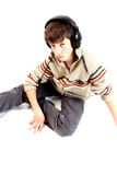 Music. A teen boy and music royalty free stock image